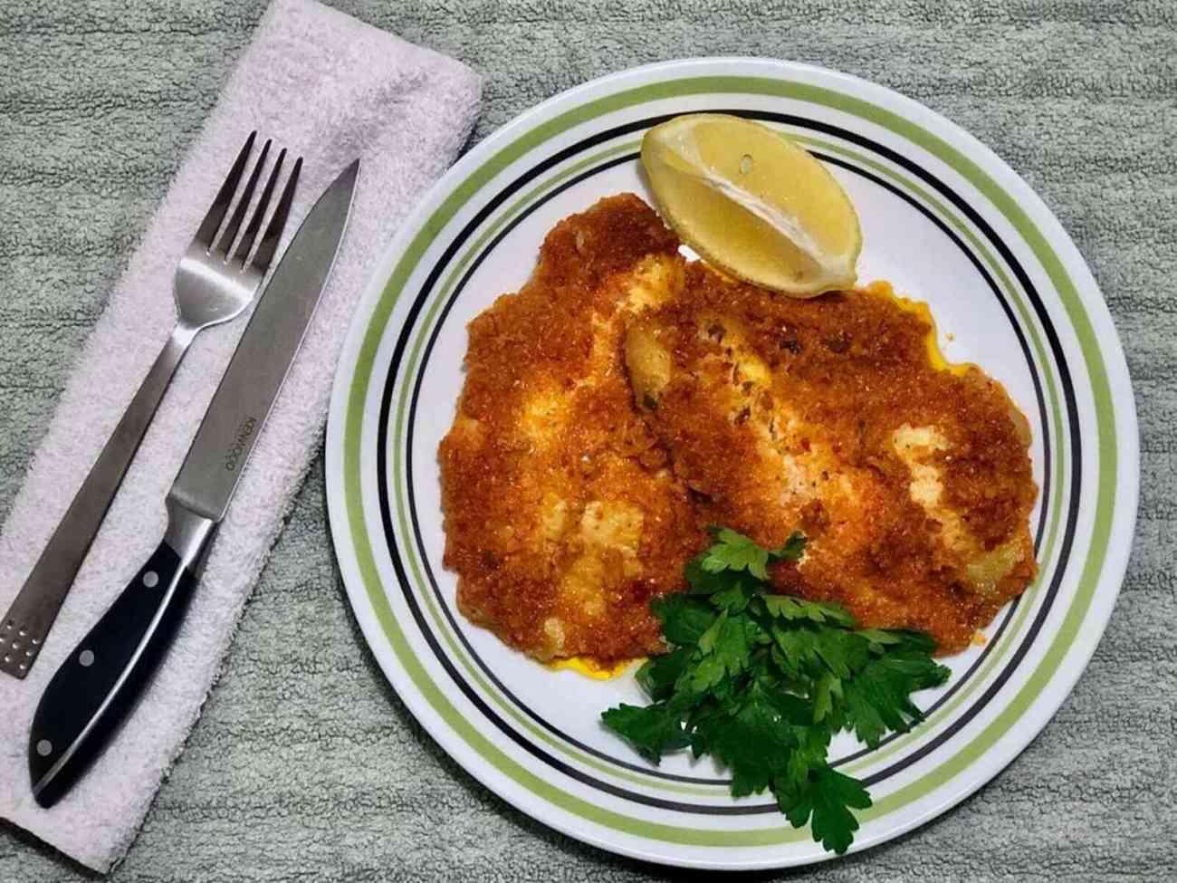 דג אמנון בתנור עם ממרח פלפלים ושום
